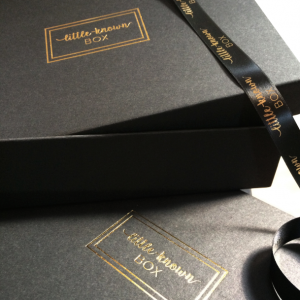 Our matte black and gold foil Little-Known Boxes